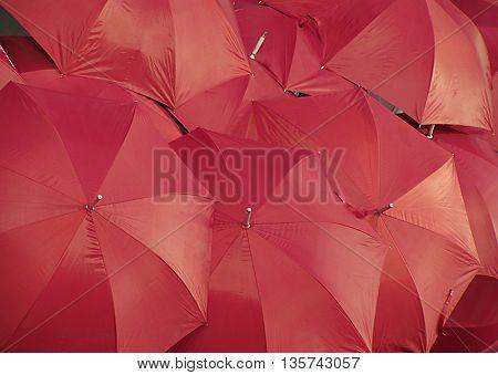 Open red umbrellas