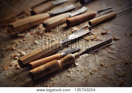 chisel and cutting wood equipment in carver workshop
