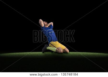 Frustrated soccer player in blue uniform isolated on football training on green grass