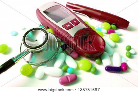 stethoscope,device for measuring blood sugar level and different kind of pills