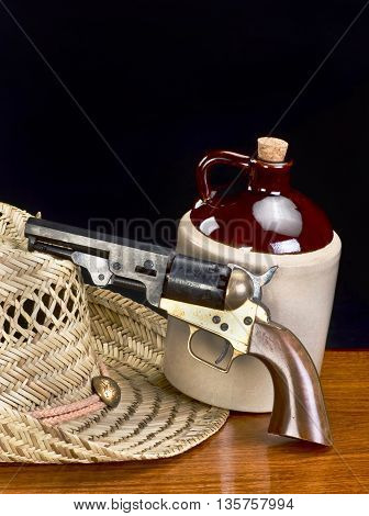 Old western six shooter and jug of white lighting with room for your type.