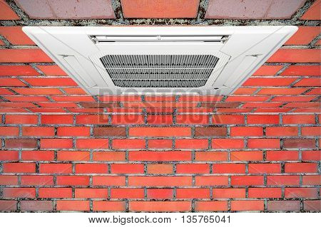 Built-in air conditioner for home and office embedded on the ceiling made of red brick.