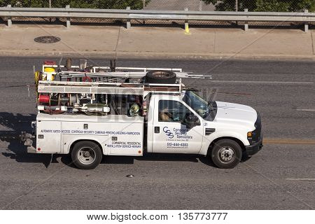 AUSTIN TX USA - APR 11: Plumber pickup truck on the road in Austin. April 11 2016 in Austin Texas United States