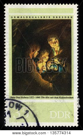 GERMANY - CIRCA 1977: a stamp printed in the Germany, Democratic Republic (DDR)  shows old person with the coal washbasin, painting by Peter Paul Rubens, circa 1977
