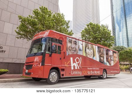 HOUSTON USA - APR 14: Red public library bus downtown in Houston. April 14 2016 in Houston Texas United States