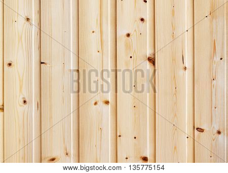 Wood pine planks lite brown texture fragment as a background composition.