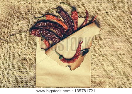 Chilli Pepper In Paper On Burlap