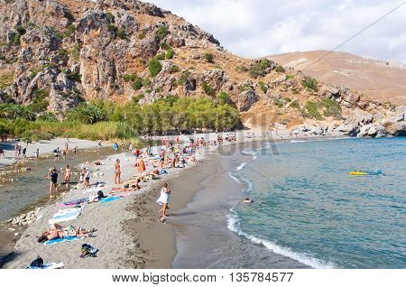 CRETEGREECE-JULY 23: Holidaymakers on the Preveli Beach on July 232014 on Crete Greece. The beach of Preveli is situated 40 km south of the main town and is the most idyllic beach in Crete.
