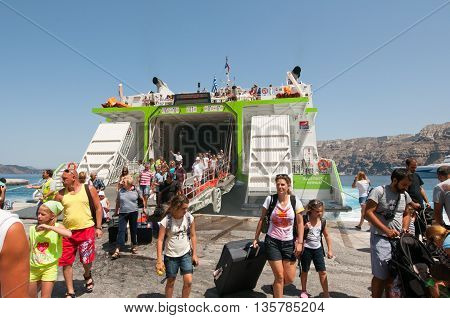 SANTORINI-JULY 28: Tourists arrive in the port of Thira also known as Santorini on July 28 2014 in Greece.