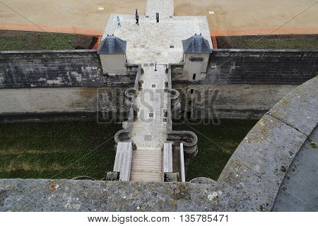 PARIS, FRANCE - MAY 15, 2015: This is the bridge over the moat of Vincennes Castle with a height of the medieval donjon.