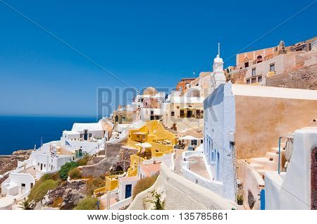 Colorful Oia village on the edge of the Santorini Caldera cliffs on the island of Thira (Santorini) Greece.