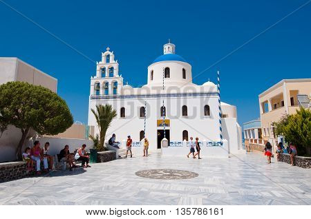 SANTORINIOIA-JULY 28: The Church of Agia Irini on July 282014 in Oia village on the Santorini island Greece. Oia is a small town on the islands of Thira (Santorini) and Therasia Greece.