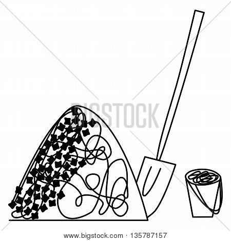 Pile of coal or ballast with shovel and pail