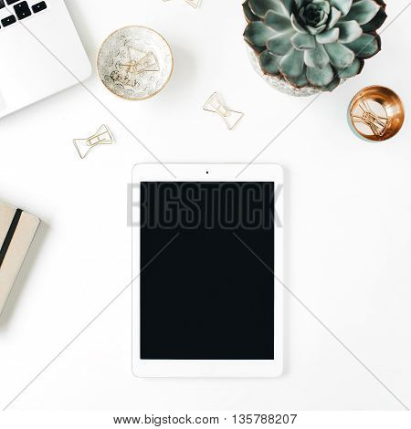 feminini desk workspace with succulent laptop tablet scissors diary and golden clips on white background. flat lay top view