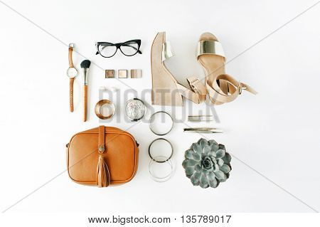 flat lay feminine accessories collage with purse watch glasses bracelet lipstick sandals mascara brushes on white background.