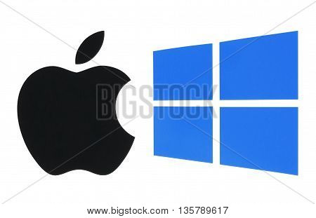 Kiev Ukraine - June 03 2016: Popular operating system logos printed on paper: Apple ios and Windows