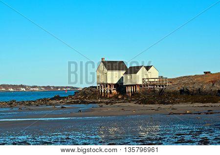 beautiful coastal fishing shacks at low tide