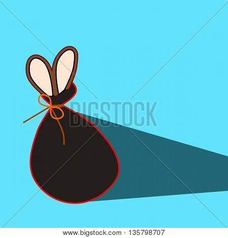 Hare in a bag. Long ears of some animal popped out of the bag, which is tied with string. Behind the bag is long shadow.