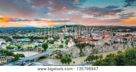 Evening View Of Tbilisi At Colorful Sunset, Georgia. Summer Cityscape. On Photograph Visible A New Concert Hall, Avlabar Residence - Presidential Administration Of Georgia, Holy Trinity Cathedral Of Tbilisi, Metekhi Church, Old Historic District Abanotuba poster
