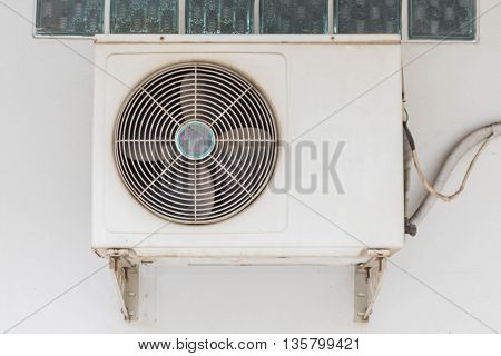 Air conditioner split type embed on wall of living room.