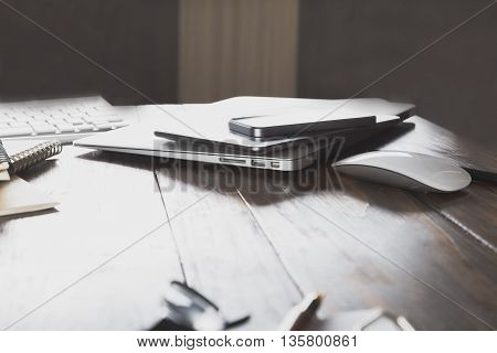 Laptop Computer, Mobile Phone And Tablet On Office Desk