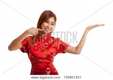 Asian Girl In Chinese Cheongsam Dress Point To  Blank Space On Her Hand