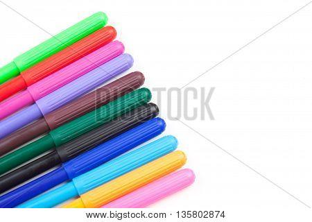 color soft-tip pen on white background concept