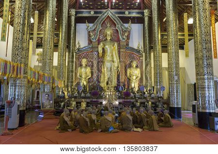 Buddhist Monk Praying Together In Asian Temple
