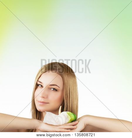Portrait of a beautiful young woman with calla flower over clear background, healthy lifestyle, beauty treatment, enjoying dayspa