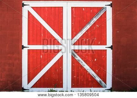 Barnyard Door. Traditional red and white barn door background.