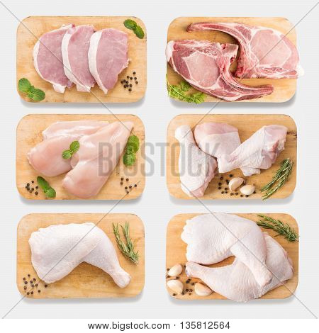 Mockup Raw Chicken And Pork On Cutting Board Set On  Isolated On White Background. Copy Space For Te