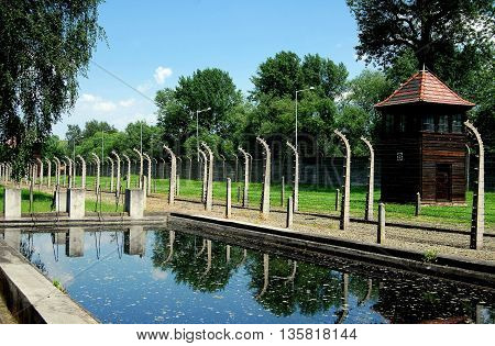 Auschwitz Poland - June 9 2010: Remains of one of the swimming pools the Nazis built to demonstrate to Red Cross observers that prisoners at Auschwitz had a good life