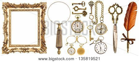 Collection of golden vintage accessories and antique objects. Old keys picture frame clock loupe compass ink feather pen scissors glasses isolated on white background