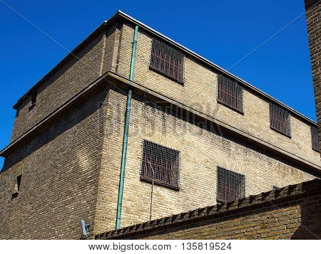 Old prison jail and windows with heavy iron bars