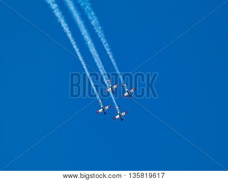Aerial aerobatics Israeli Air Force IDF on Israel Independence Day in clear blue sky