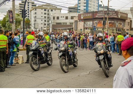 QUITO, ECUADOR - JULY 7, 2015: Pope Francisco security around the city, people on the streets saying Welcome. Police taking care of the event.
