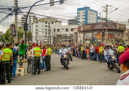 QUITO, ECUADOR - JULY 7, 2015: Motorcycles passed on the streets before pope Francisco, street crowded to say Welcome.