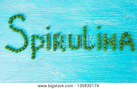 Spirulina. Pharmacological tablet form. Super food for health.