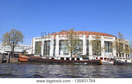 AMSTERDAM, NETHERLANDS - MAY 6, 2016: Dutch National Opera & Ballet Nationale opera and ballet building (Stopera) in Amsterdam, Netherlands. The Stopera is located in the center of Amsterdam.