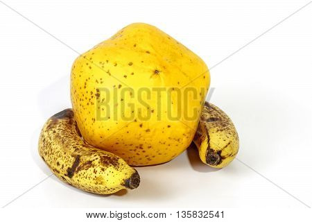 Yellow Paw Paw With Two Ripe Speckled Bananas