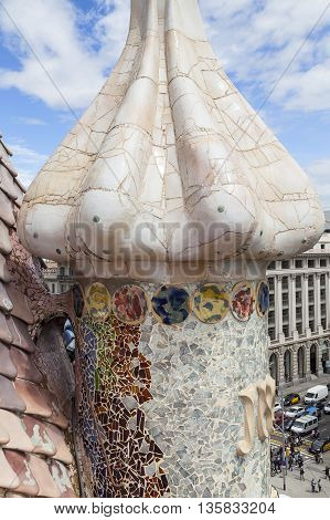 BARCELONA SPAIN - MAY 11 2016 : Casa Batllo housetop chimneys with ceramic mosaic. Building redesigned in 1904 by Gaudi located in the center of Barcelona it is on the UNESCO World Heritage Site.