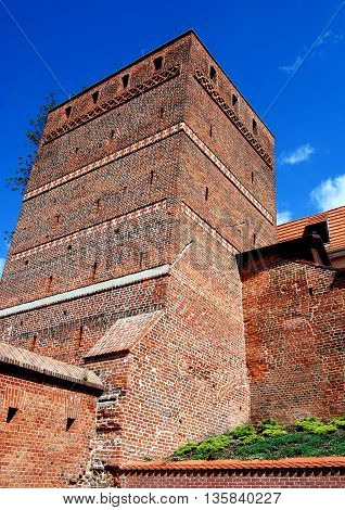 Torun Poland - May 26 2010: Outer wall facade of the 13th century square Leaning Tower (Krzywa Wieza) is a city landmark with its 1.40m inclination