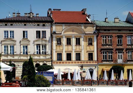 Tarnow Poland - June 12 2010: Baroque 18th century houses and outdoor cafés in the charming Rynek market square