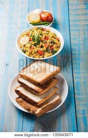 Masala Anda Bhurji of egg bhurji or Spicy scrambled eggs with bread or pav or paav slices and salade, anda bhurji paav poster