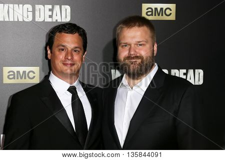 NEW YORK-OCT 9: Producer Dave Alpert (L) and writer Robert Kirkman attend AMC's 'The Walking Dead' season six premiere at Madison Square Garden on October 9, 2015 in New York City.