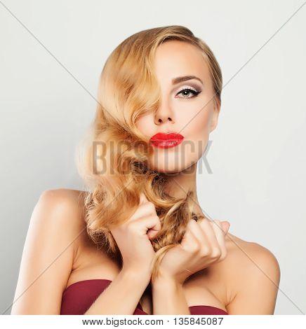Blond Woman. Fair Hair Makeup Hollywood Wave Hairstyle