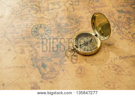 Old vintage compass on vintage map background