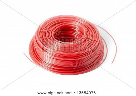 A spool of red replacement trimmer line for a weed eater.