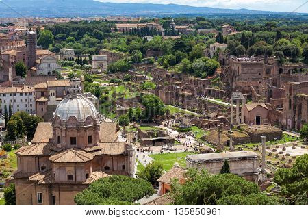 Old ruins of the Roman Forum (Foro Romano) at the center of the city of Rome, Italy