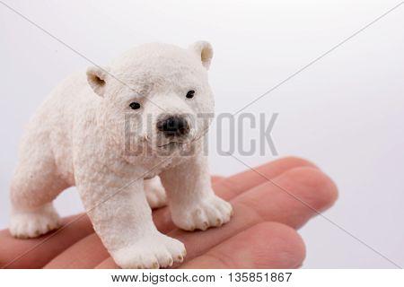Hand holding  a White Polar bear model